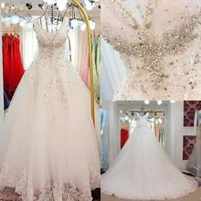 Luxury Crystals Beaded Wedding Dresses 2021 V Neck A Line Bridal Gowns Lace Up Bow Back Sweep Train Wedding Dresses Custom Made new pink baby girls birthday dresses sweep train beaded applique kids formal wear bow flower girls dresses custom made