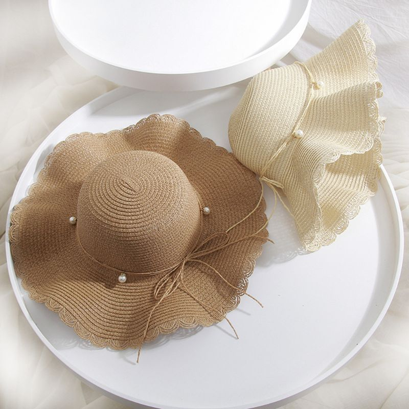 Womens Summer Straw Weave Wide Wavy Brim Sun Visor Hat Scalloped Trim Imitation Bowknot Floppy Beach Travel Holiday Bucket Cap