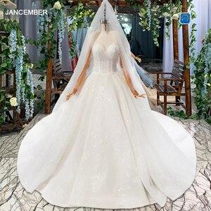 Image 1 - HTL823 فساتين زفاف لامعة مع الحجاب الزفاف الوهم o الرقبة فساتين زفاف طويلة مع الأكمام vestido de noiva 2020