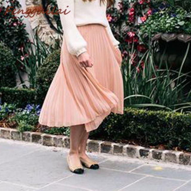 Фото женская плиссированная юбка средней длины на пуговицах однотонная