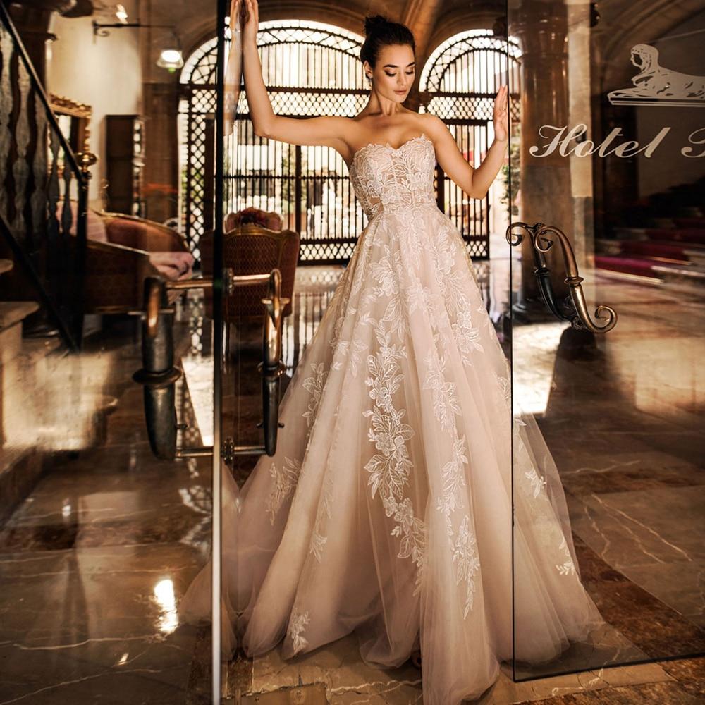 Gorgeous Strapless Lace Wedding Gown Appliqued Champagne Bridal Dress 2020 Robe De Mariee Customized Corset Bride Dress