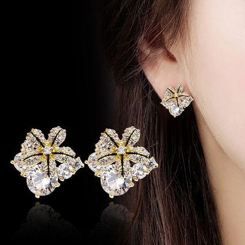 Женские серьги гвоздики с цирконом золотого и серебряного цвета