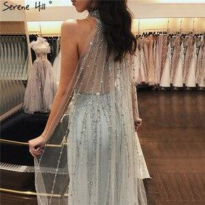 Image 2 - Dubai gümüş lüks Mermaid abiye tasarım kolsuz seksi boncuk Illusion resmi elbise 2020 Serene tepe LA70087