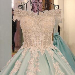 Image 4 - LS21700 חדש כדור שמלת ערב שמלות תחרה עד בחזרה חזרה קצר שרוולי תחרת הערב רשמי שמלות שמלות אור ירוק אמיתי תמונות