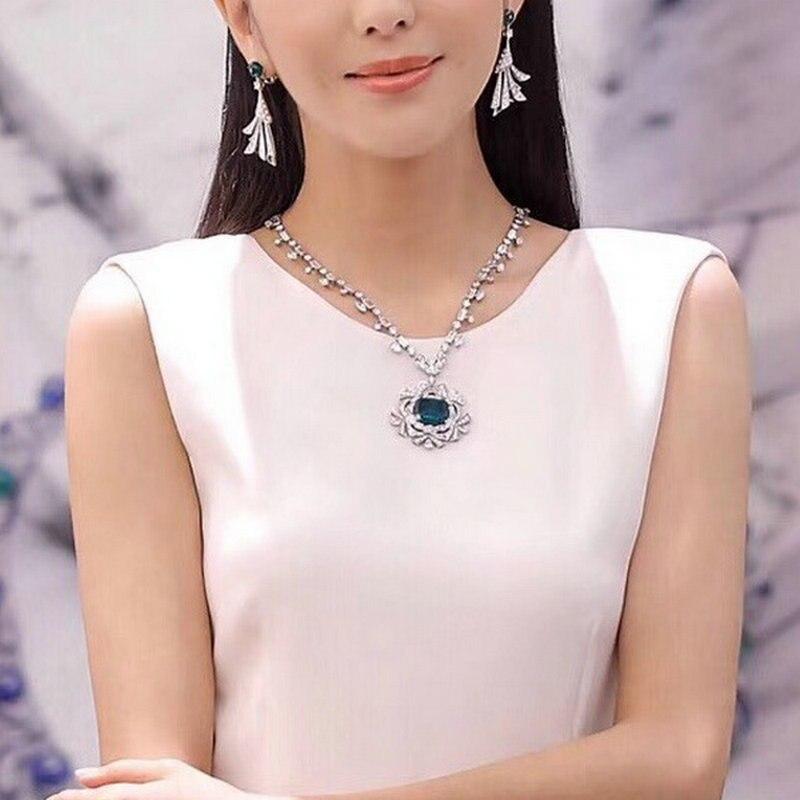 Mode de luxe saphir émeraude pierre collier fleur rotin diamant chandail chaîne pendentif incrusté Super clignotant grande pierre gemme