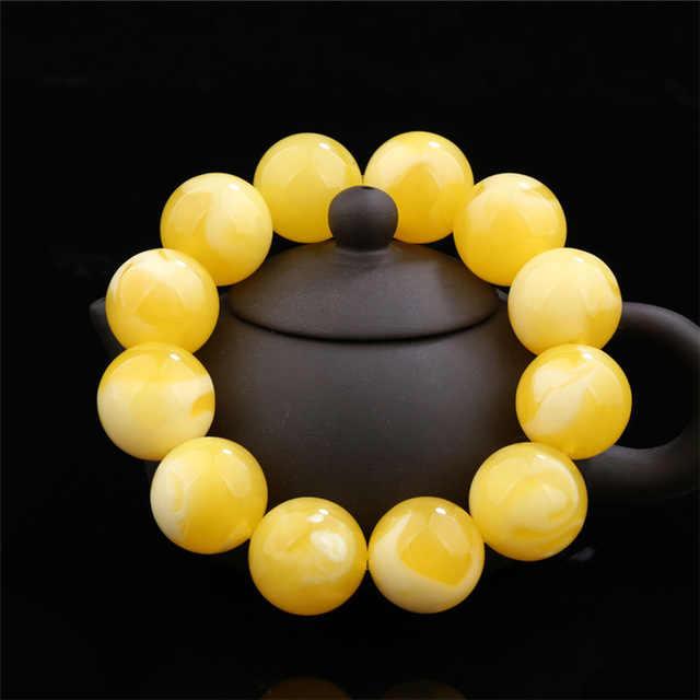 ขี้ผึ้งธรรมชาติสร้อยข้อมือผู้ชายและผู้หญิงดอกไม้สีขาว amber สร้อยข้อมือผู้หญิง amber ดิบ ore ไก่สีเหลืองสร้อยข้อมือคริสต์มาส