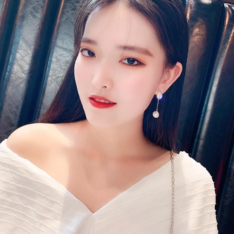 925 silver needle with zircon earrings Japanese and Korean temperament angel wing ear pendant elegant pearl ear nail girl in Drop Earrings from Jewelry Accessories