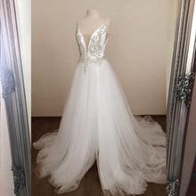 2020 niesamowite białe długie sukienki balowe musujące kamienie Sexy line Party Dress Tulle szczelina lewa formalne suknie balowe taniec YQLNNE