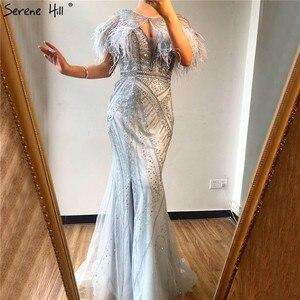 Image 2 - فستان رسمي 2020 بحورية البحر بفتحة رقبة على شكل حرف v من دبي ، فستان سهرة مثير بالريش الفضي والغزل DLA70355