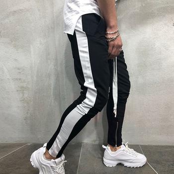Dorywczo spodnie męskie spodnie hip-hopowe spodnie skinny fit spodnie dresowe Streetwear męskie spodnie boczne paski modne męskie spodnie joggery tanie i dobre opinie Ołówek spodnie Na co dzień Zipper fly Other Joggers pants men Mieszkanie Midweight Pełnej długości COTTON Suknem joggers hip hop