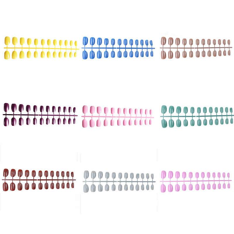 Lembut Permen Warna Kepala Oval Kuku Palsu Acrylic Palsu Nail Art Salon Tips dengan 2G Lem Kuku Penuh Pendek bulat Kuku Tips 24 Pcs/set