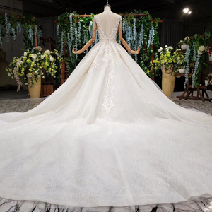 Image 2 - HTL990 lace wedding dress in Wedding Dresses o neck short sleeved bead wedding gowns with tail illusion back vestidos de noivas