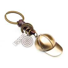 Creative keychain men and women small gifts alloy baseball cap retro woven leather keychain