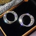 Huitan класса люкс с креплением микро-паве Ослепительная с фианитами (CZ), классические серьги-гвоздики в форме снежного серьги серебряный цвет...