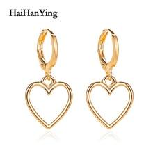 цены New Creative Hollow Love Women Earrings Temperament Wild Metal Peach Heart Earrings Simple Luxury Charm Jewelry