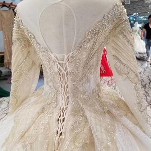 Image 5 - LSS088 luxury dubai glitter wedding gowns o neck long sleeve shiny lace flowers wedding dresses long train latest new design