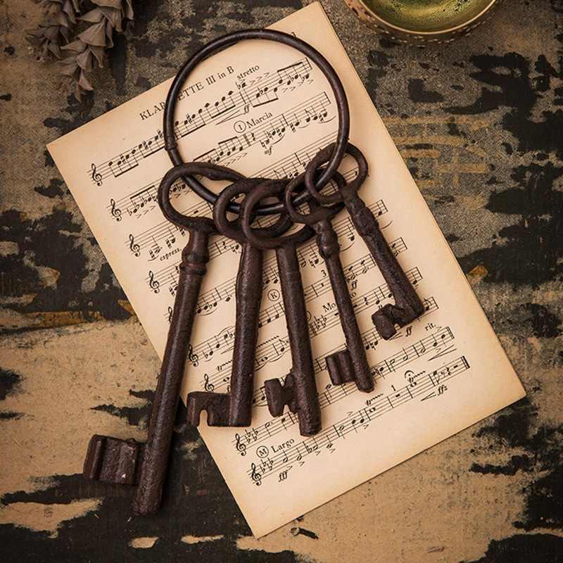 RUSTIC DARK BROWN SET OF 4 CAST IRON OLD FASHION SKELTON KEYS ON RING