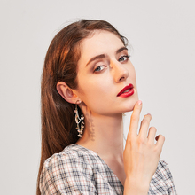 Golden world simple flower long tassel ear pendant female super fairy small fresh personality design earring korean earrings
