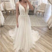 Boho Wedding Dresses 2020 Appliques Beaded Top Sleeveless V Neck Open Back A line Tulle Beach Wedding Gowns Bride Dress vestidos