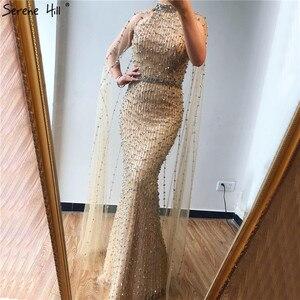 Image 5 - Dubai gümüş lüks Mermaid abiye tasarım kolsuz seksi boncuk Illusion resmi elbise 2020 Serene tepe LA70087