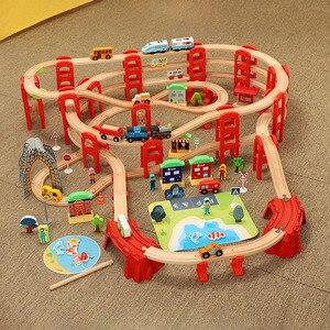 Деревянная железная дорога железнодорожные пути набор игрушек гараж для автомобилей Электрический поезд кольцо многослойный деревянный т...