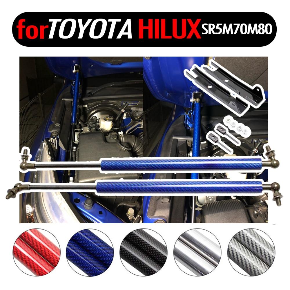 Lift Penopang untuk Toyota Hilux SR5 M70 M80 Revo 2015-2019 Depan Hood Bonnet Gas Struts Shock Serat Karbon