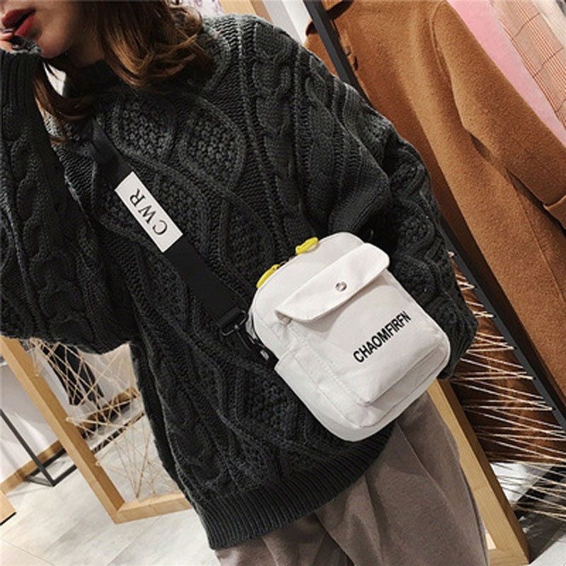 On the 19th it is a fresh canvas bag female letter oblique bag single shoulder cute large capacity girl riding a small bag stud in Top Handle Bags from Luggage Bags
