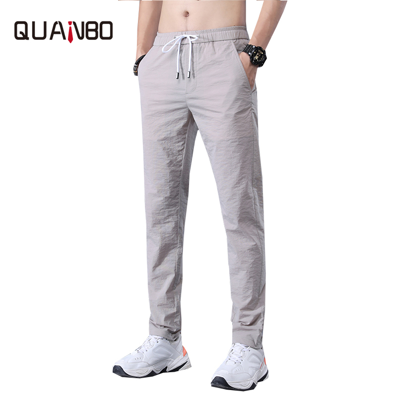 QUANBO 2020 Summer New Men's Ice Silk Casual Pants Men's Slim Straight Thin Section Fashion Trousers Male Small Feet  Pants