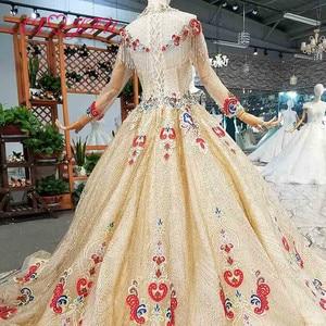 Image 2 - AXJFU יוקרה נסיכה ואגלי קריסטל אדום פרח זהב תחרה גבוהה צוואר ארוך שרוול אשליה הכלה זהב חתונה שמלת 4041