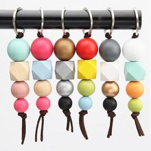 Nowe mody wielokolorowe geometryczne koraliki drewniane brelok do torby koraliki drewniane kule Kechains prezenty torby akcesoria cheap Clyine wood keychain Lekki organizatorzy 1 piece Beads