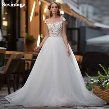 Трапециевидный силуэт; Кружевное свадебное платье с рукавом