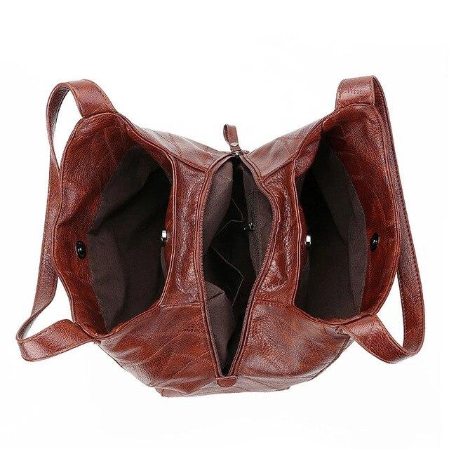 Женская кожаная сумка с ручками и тремя отделениями 6
