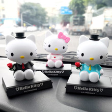 Hello kitty car shake head decorations car accessories for girls Cute desktop phone base omament accesorios para autos Car dolls(China)
