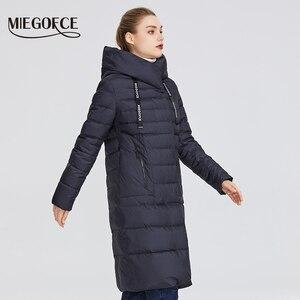 Image 2 - MIEGOFCE 2019 Новая зимняя женская коллекция курток длина до колен ветрозащитный женская куртка со стоячим воротником и капюшоном имеет наладные карманы на молнии двойная защита от холода на молнии и на застежках