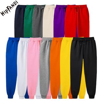 Czarne białe spodnie dresowe męskie zimowe spodnie na co dzień elastyczne czerwone polarowe spodnie męskie długie jesienne modne spodnie markowe kolorowe nowe tanie i dobre opinie HIPFANDI Proste Pełnej długości Mieszkanie REGULAR Poliester Lycra 140 - 165 Terry Kieszenie W stylu Preppy Sznurek WK00