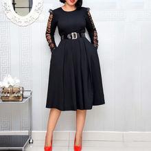 Черное элегантное женское платье с длинным рукавом и вырезом