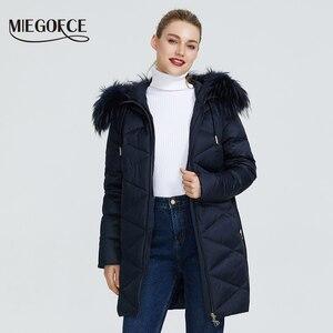 Image 2 - MIEGOFCE 2019 Новая зимняя женская коллекция курток куртка женская зимняя необычайный дизайн имеется капюшон с мехом длина до колена теплая женская куртка биопух сохраняет тепло и придает легкость