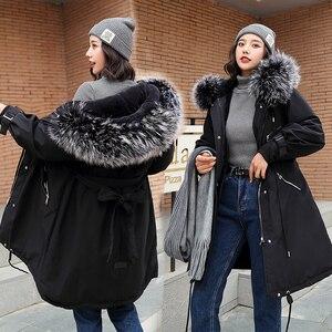 Image 2 - Chaqueta de invierno con capucha para mujer, nueva con capucha de piel grande, larga, con forro de piel, gruesa, cálida, para nieve, 2019