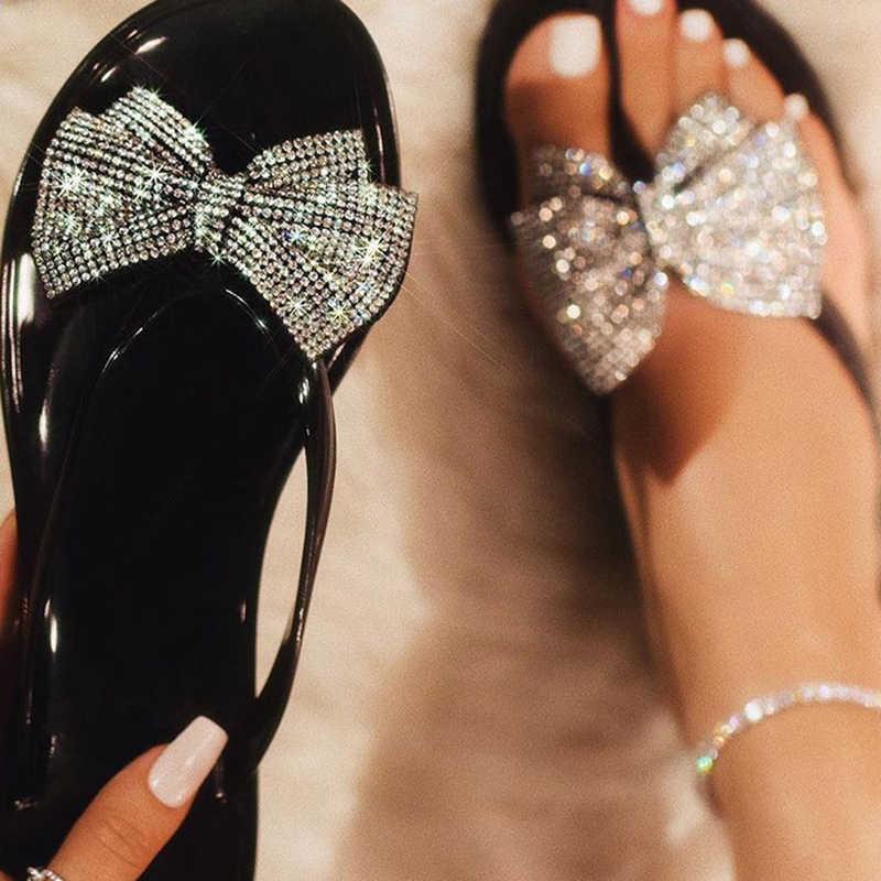 Arco strass lantejoulas sexy material pvc sandálias femininas geléia-colorido pvc plana sandálias 36-41 tamanho