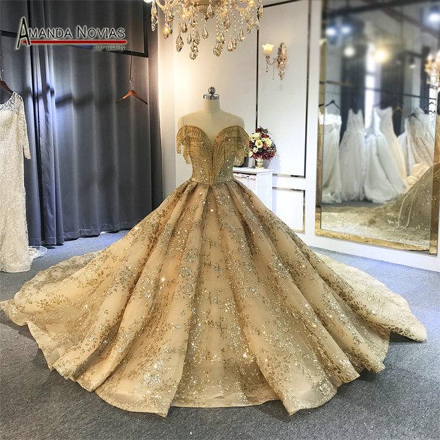 Off the shoulder golden ball gown wedding dress