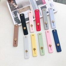 Banda de muñeca de Color liso banda de mano agarre de dedo soporte de teléfono móvil Push Pull Universal soporte de enchufe de teléfono para Iphone x xr 7