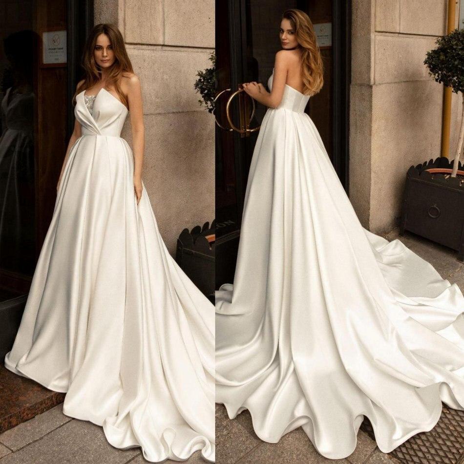 2020 Designed Wedding Dresses Sweetheart Backless Satin Bridal Gowns Custom Made Sweep Train A-Line Wedding Dress