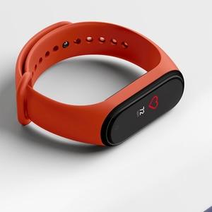 Image 4 - Stokta orijinal Xiaomi Mi Band 4 akıllı renkli ekran akıllı bilezik kalp hızı spor 135mAh Bluetooth 5.0 50M yüzme su geçirmez