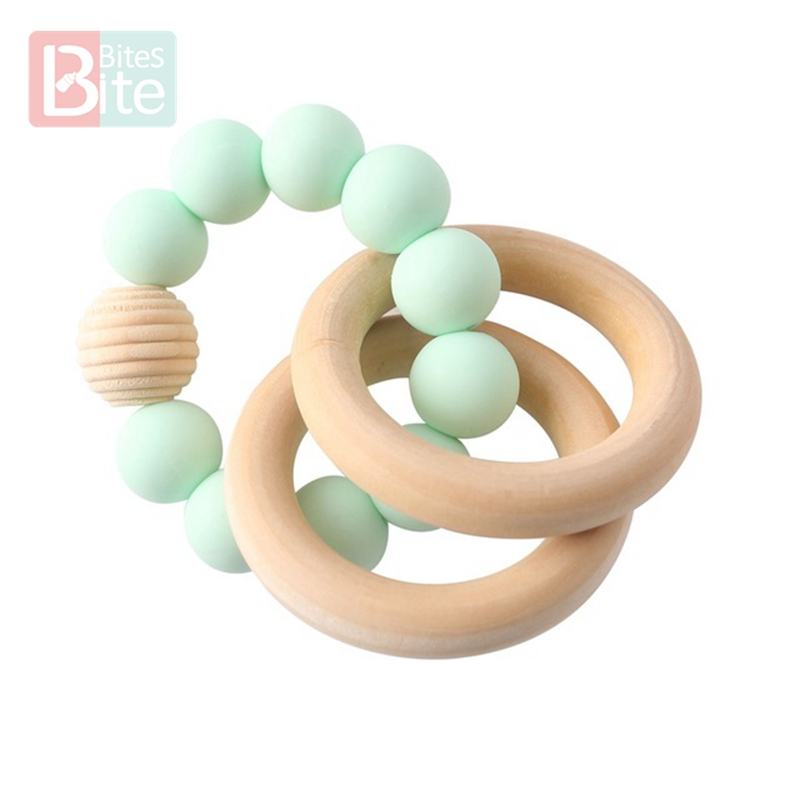 Купить с кэшбэком Bite Bites 1PC Baby Teether Customize Name Bracelet Silicone Star Beads Chewing Wooden Ring Trolley Rattle For Kids Products Toy