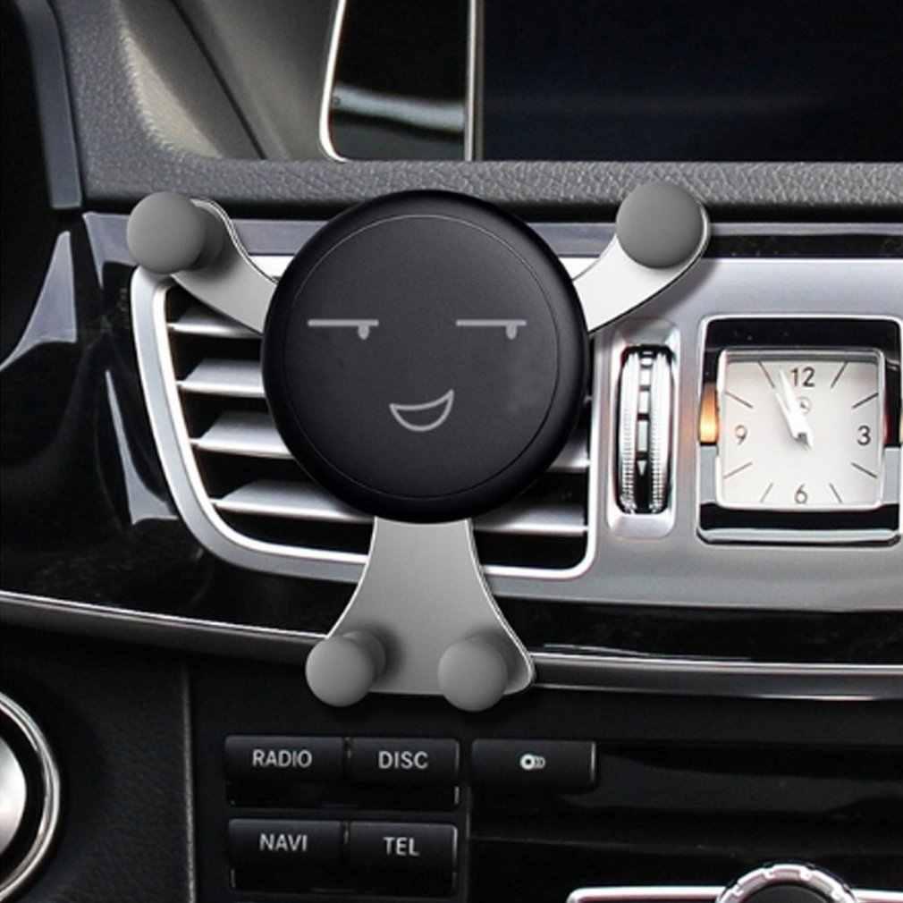 Diseño de expresión de cara Kawaii soporte de montaje en salida de aire de coche soporte de ventilación de aire para vehículo soporte de cuna para teléfono móvil