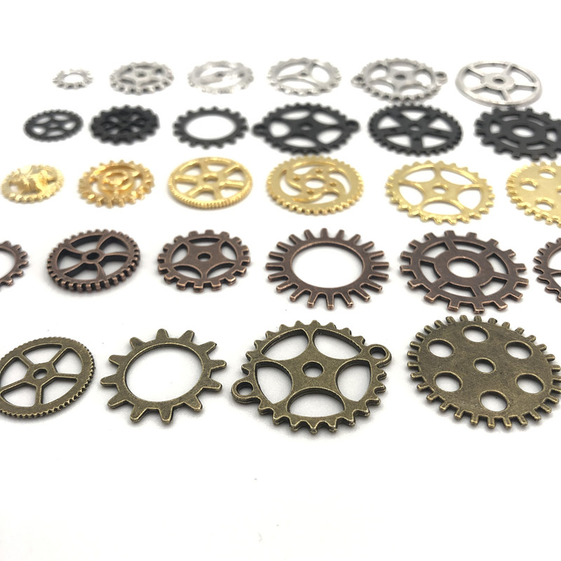 4 STEAMPUNK GOLD COGS//GEARS  MADE FROM METAL ALLOY  AND EACH PIECE IS 40mm