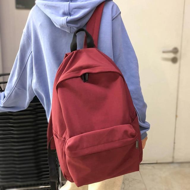 DCIMOR nowy wodoodporny nylonowy plecak damski Japan Style Solid Color Mochila Feminina Mujer torba podróżna tornister dla nastolatki