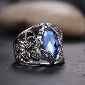 Huitan Single Big Blue Horse Eye Drill Mosaic Finger Ring for Women Hollow Leaves Pattern Around Hyperbole Wedding Ring Punk SKU