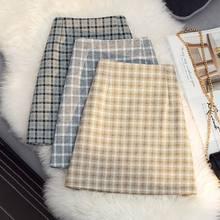 Saia xadrez feminina primavera 2021 nova versão coreana de cintura alta a linha saia retro temperamento all-match saco saias quadril feminino