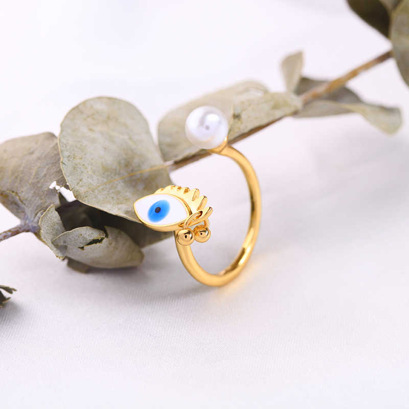 Wing yuk tak แหวนผู้หญิงไข่มุกจำลอง Evil Eye แฟชั่นเปิดนิ้วมือแหวนเคลือบเครื่องประดับของขวัญ